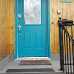 Front porch with blue door and a keypad lock