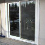White sliding glass door coming off of a deck