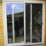 Sliding glass door on wood sided home