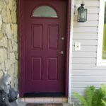 Front porch of home featuring new installed maroon door