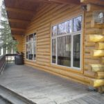 Alaskan log home with new large windows