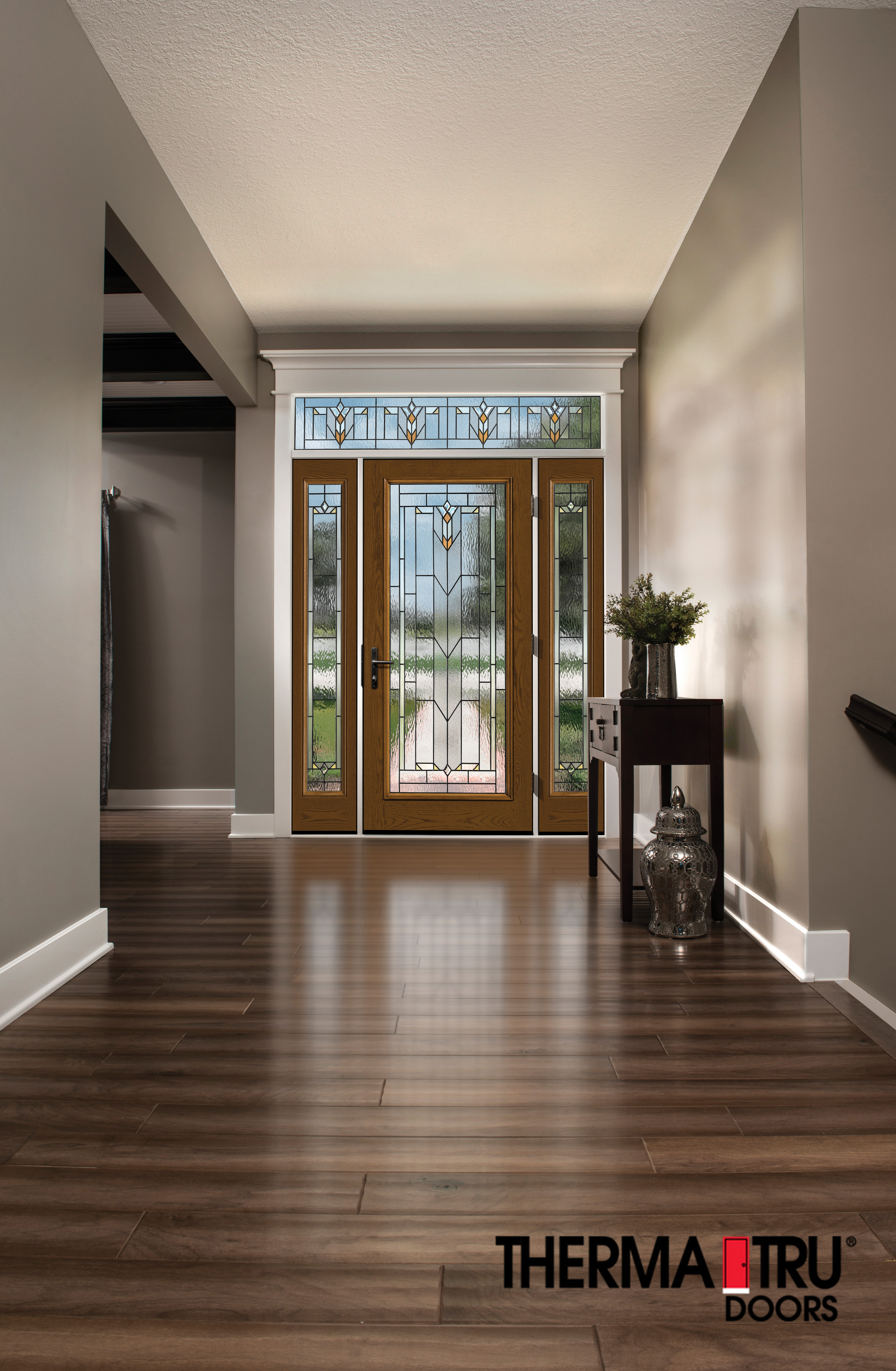 Well-lit entry way with glass door and hardwood floors